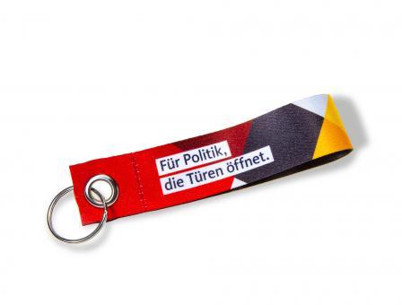 """Schlüsselanhänger """"Für Politik, die Türen öffnet."""""""